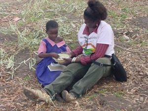 Comfort feeding school girl in Malawi